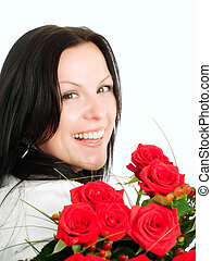 smiling brunette woman with bouquet of flowers