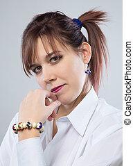 Smiling brunette woman with bracelet