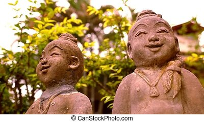 Smiling Buddha sculpture, Thailand. Video macro shift motion...