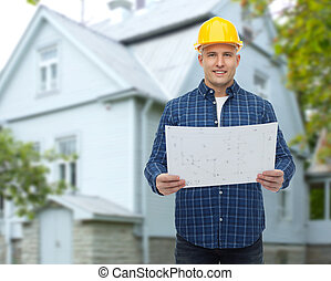 House over blueprint real estate concept pictures search smiling builder with blueprint over house malvernweather Image collections