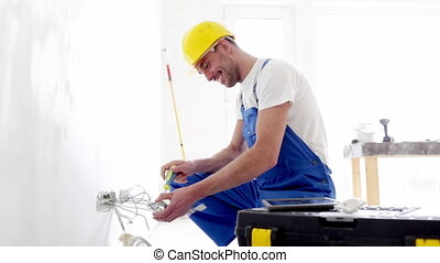 smiling builder with tablet pc and equipment - building, ...