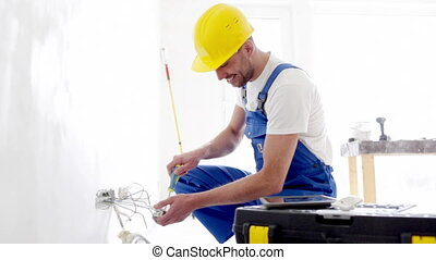 smiling builder with tablet pc and equipment