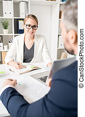 Smiling business consultant talking to entrepreneur