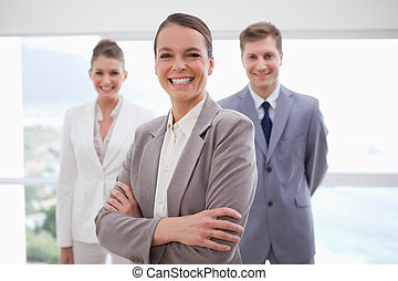 Smiling business consultant with arms folded