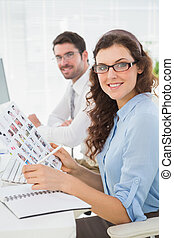 Smiling business coworkers with glasses in the office