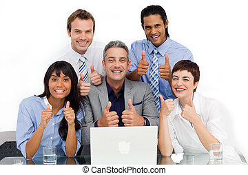 Smiling business group with thumbs up
