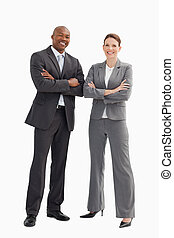 Smiling business man and woman posing