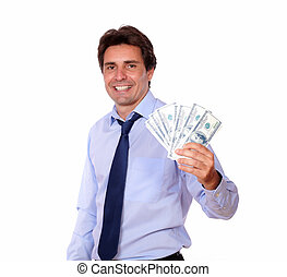 Smiling business man holding up cash money