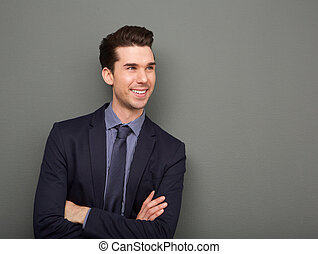 Smiling business man standing with arms crossed