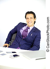 Smiling business man surrounded by technology