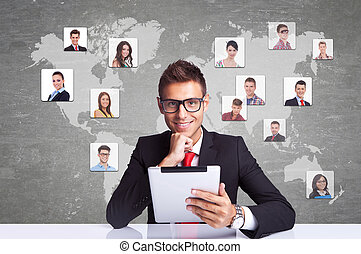 Collage with a smiling business man with tablet pad against technology background, communicating with entire world