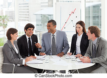 Smiling business people discussing a budget plan