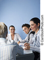 Smiling business people having a meeting