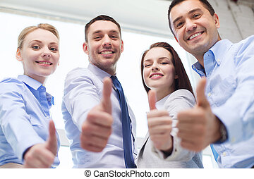 smiling business people showing thumbs up - business,...