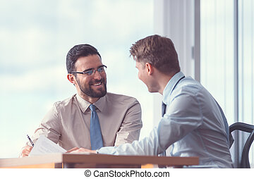 Smiling business people signing a contract