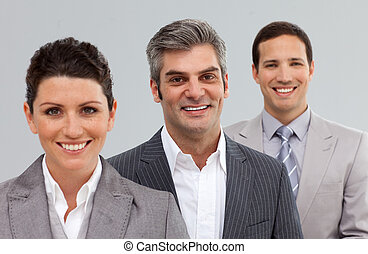 Smiling business people standing together