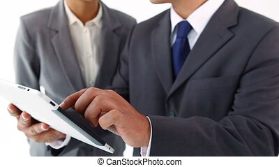 Smiling business people using a tablet pc