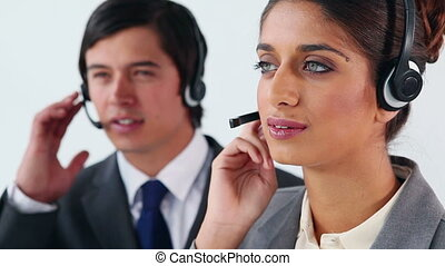 Smiling business people using headsets
