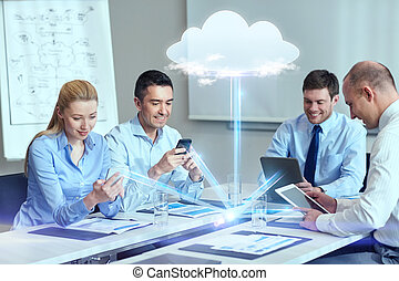 smiling business people with gadgets in office - business,...
