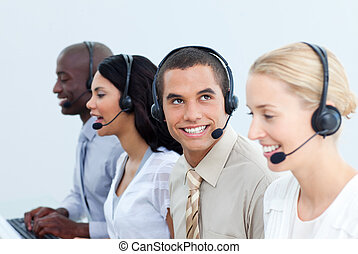 Smiling business people working in a call center