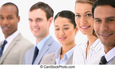 Smiling business team against a white background