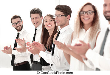 smiling business team applauding standing