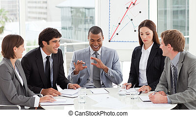 Smiling business team discussing a budget plan