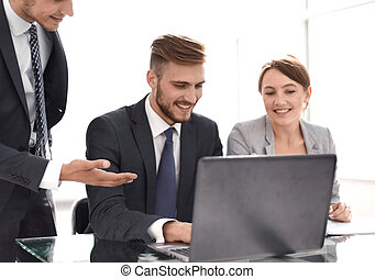 smiling business team discussing online news