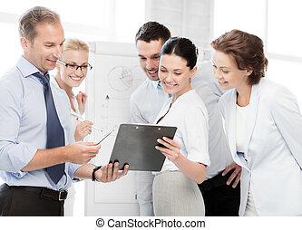 business team discussing something in office - smiling ...