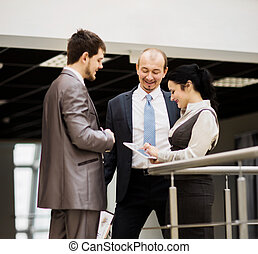smiling business team discussing something in the office