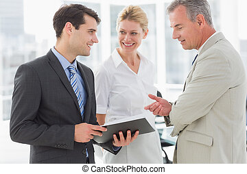 Smiling business team going over documents