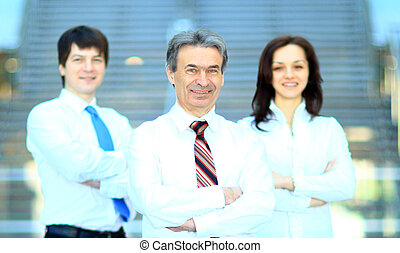 Smiling business team standing