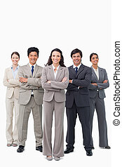 Smiling business team standing with arms folded