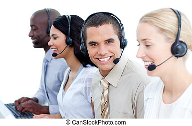 Smiling business team talking on headset