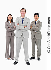 Smiling business team with folded arms