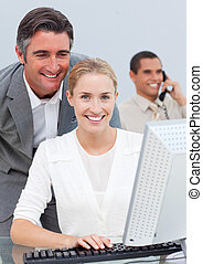 Smiling business team working in the office in a company