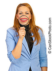 Smiling business woman hold loupe