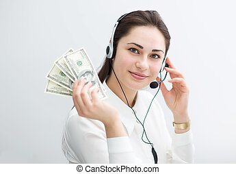 smiling business woman in headphones holds banknotes in hand