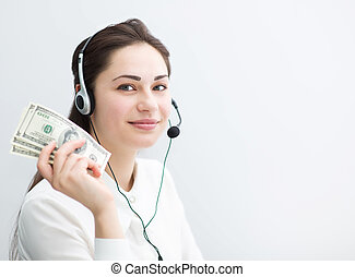 smiling business woman in headphones with banknotes