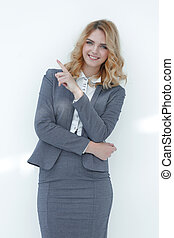 smiling business woman pointing on copy space.