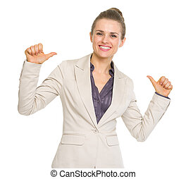 Smiling business woman pointing on herself