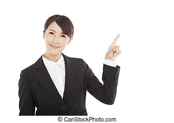 smiling business woman pointing to copy space