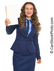 Smiling business woman showing book