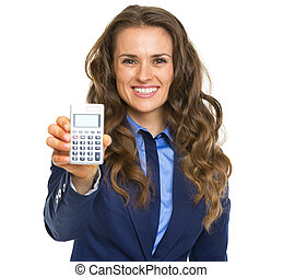 Smiling business woman showing calculator