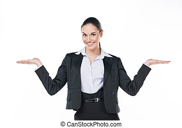 Smiling business woman showing open copy space with both...