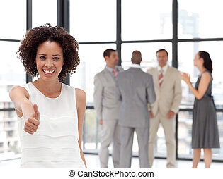 Smiling business woman showing team spirit on from of...