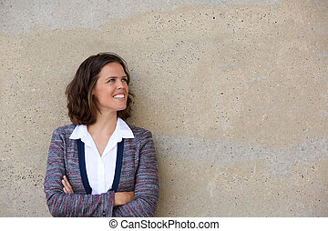 Smiling business woman standing with arms folded