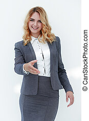 smiling business woman stretching hand for...