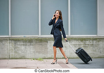 Smiling business woman walking and talking