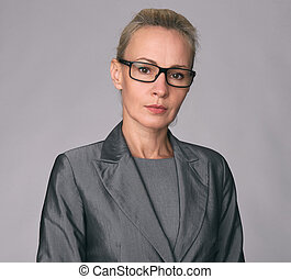 Smiling business woman wearing glasses